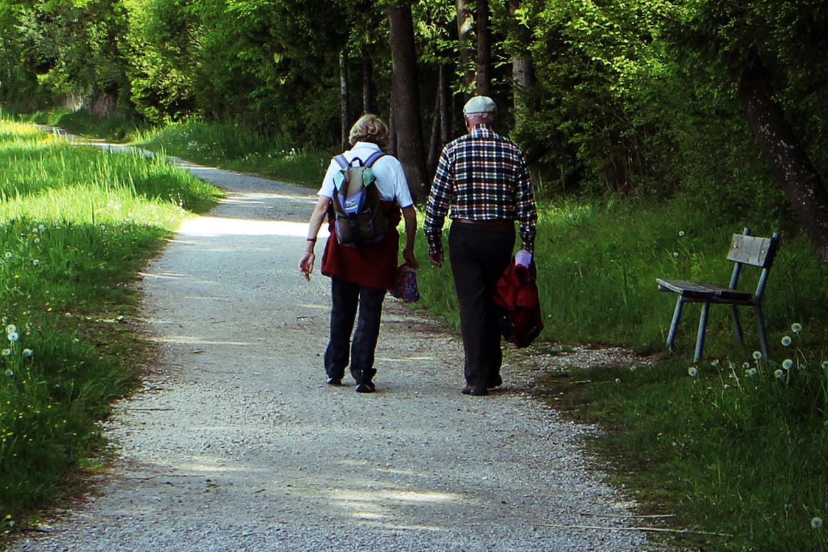Elderly couple out walking for health on a track